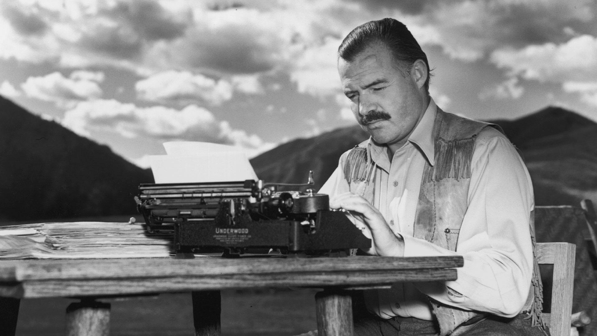 photo of Ernest Hemingway at a typerwiter