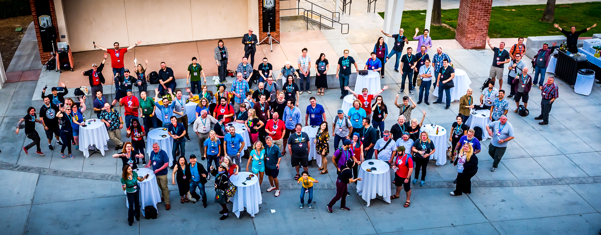 WordCamp Los Angeles 2017 attendees at the after party at Cal State LA. Wide group photo taken from a balcony above.