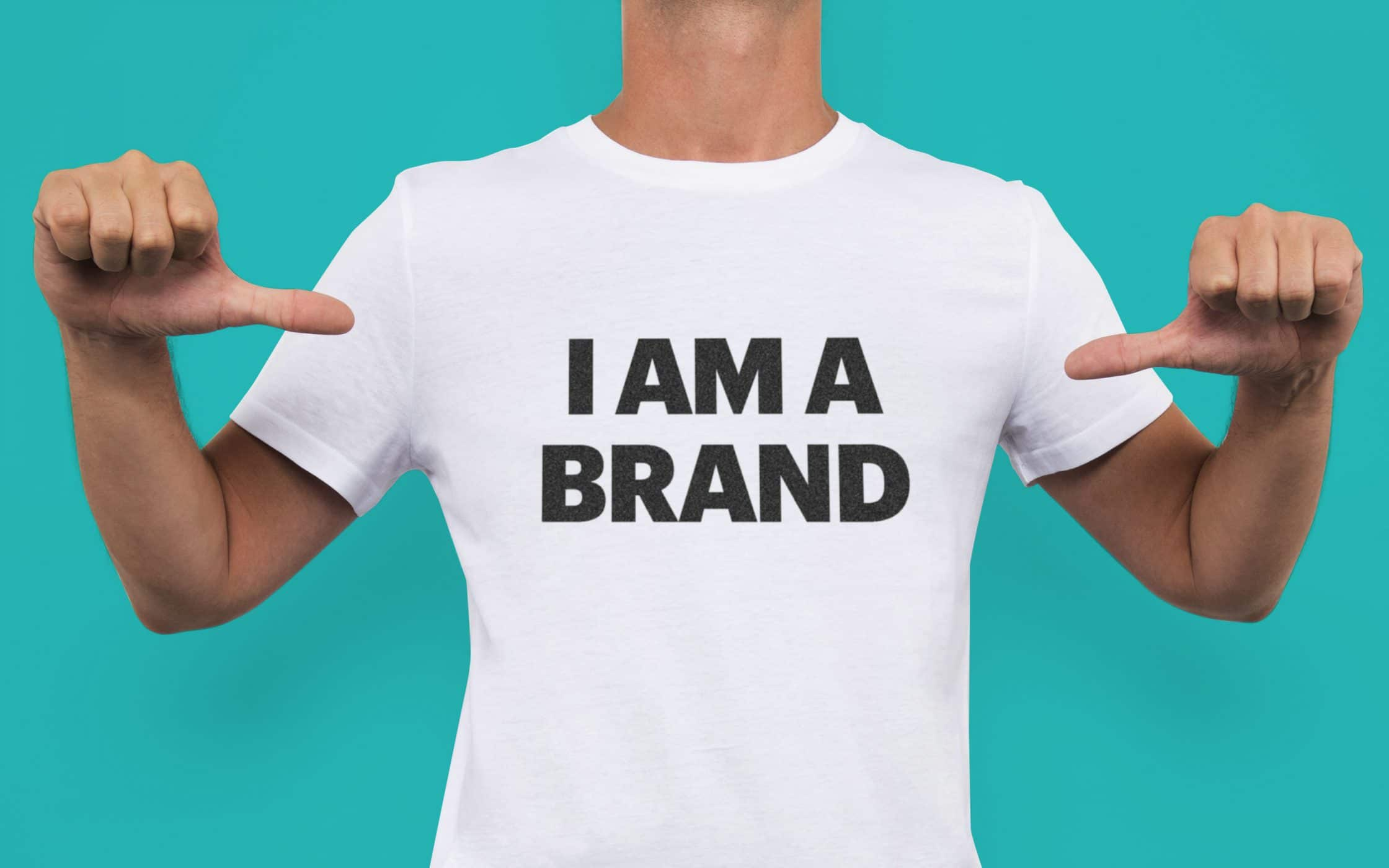 "photo of a guy wearing a t-shirt with the text ""I am a brand"""