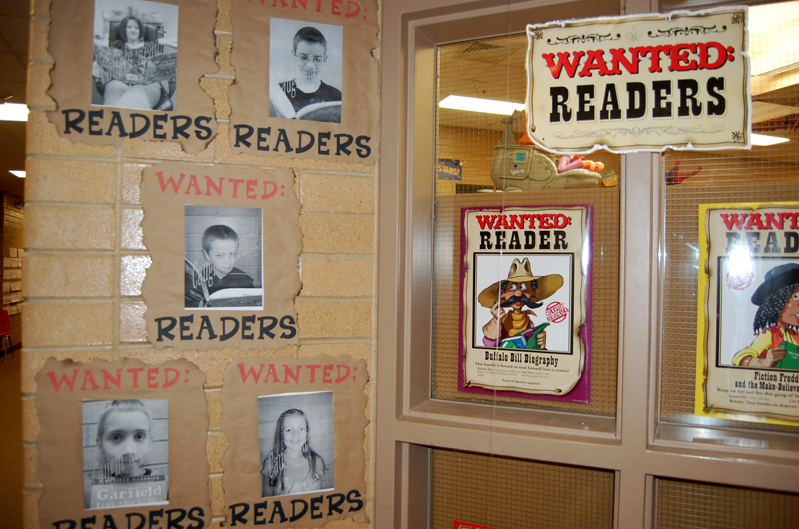 "photo of school kids with banner ""readers wanted"""