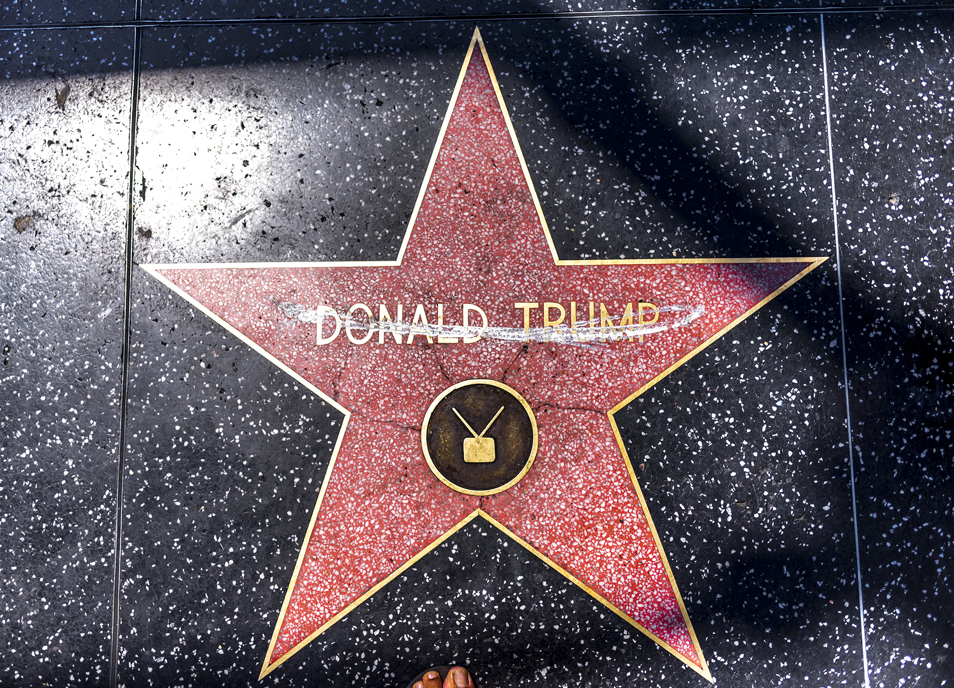 Donald Trump's star on Hollywood Blvd, with chalk lines running through his name