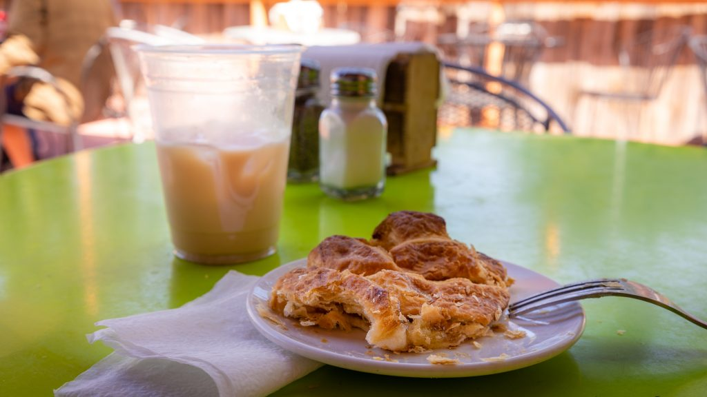 photo of an apple turnover and a iced chai drink.